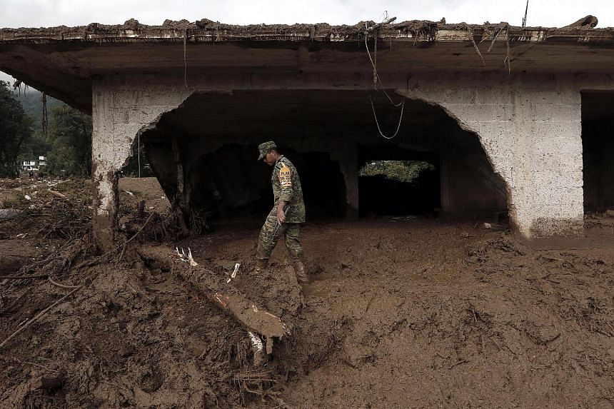 Hundreds of soldiers and rescue workers are searching for the missing after the remnants of tropical storm Earl triggered landslides in central Mexico that killed at least 45 people over the past few days. Trudging through mud that is sometimes up to