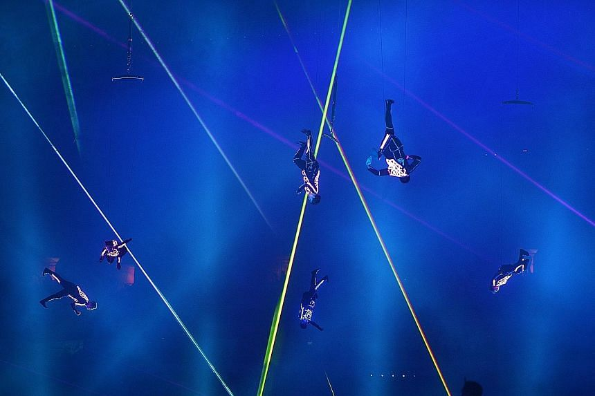 """Performers of the Badang segment go through their paces during a rehearsal. The space under the 2.5m-high stage could hold about 300 people, and there were 34 ventilation fans under the stage that kept the technicians and waiting performers cool. """"Sh"""