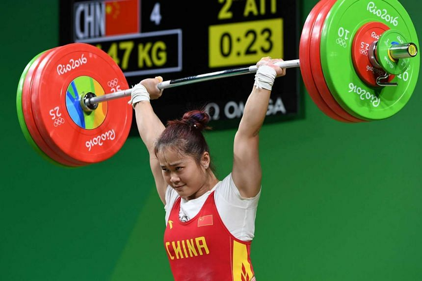 China's Deng Wei competes to break the World record and win the Women's 63kg weightlifting competition.