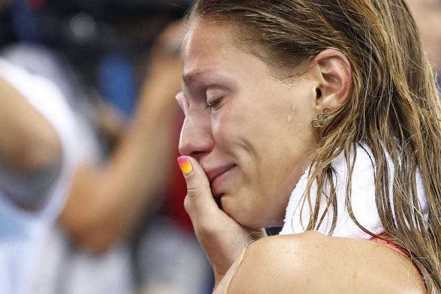 Russia's Yulia Efimova cries after placing second in the women's 100m breaststroke fFinal.