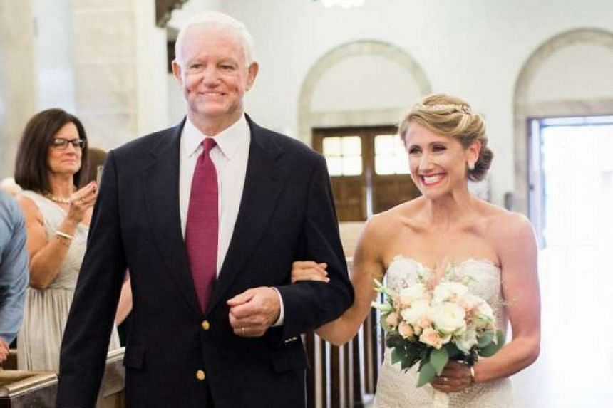 Jeni Stepien is walked down the aisle by Arthur Thomas, who received her father's heart in a transplant.