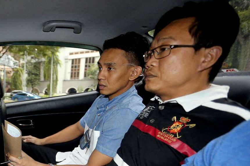 Ho Yueh Keong (right) was jailed for 20 months on Wednesday (Aug 10) for harbouring gangster Tan Chor Jin after he shot dead a nightclub owner in 2006.