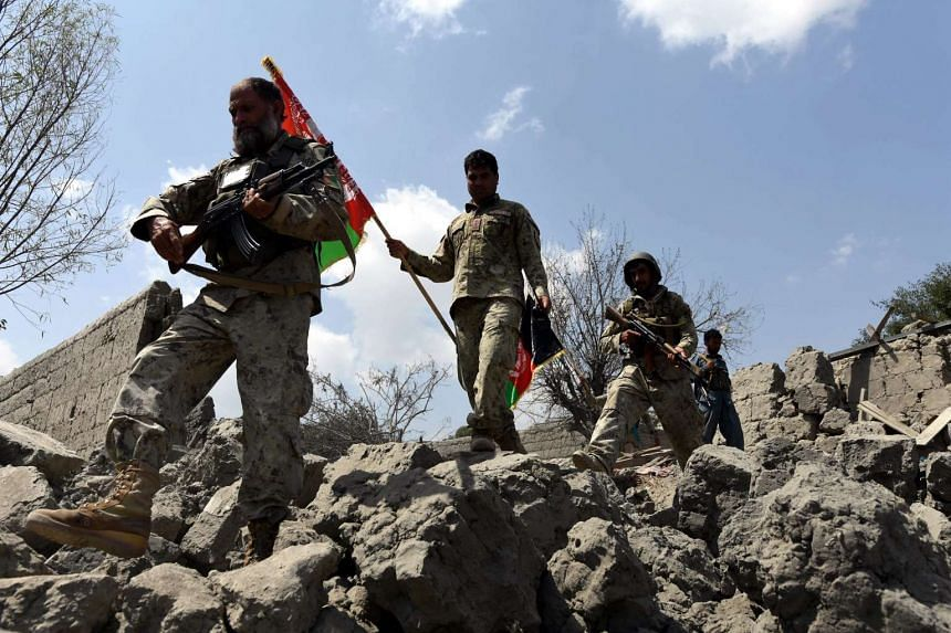 Afghan security forces surveying an area that was reclaimed from ISIS, in the Khot district of Nangarhar province, on Aug 1, 2016.