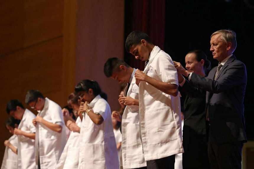 Nanyang Technological University (NTU) medical students receiving white coats at a special ceremony on Aug 8, 2016.
