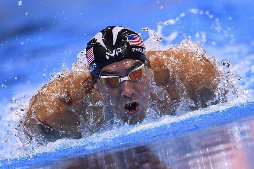Michael Phelps competes in the 200m butterfly semi-final.