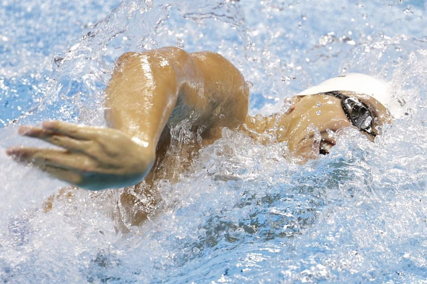 Schooling, 21, powered to second place amongst eight swimmers with a new national record time of 48.27s.