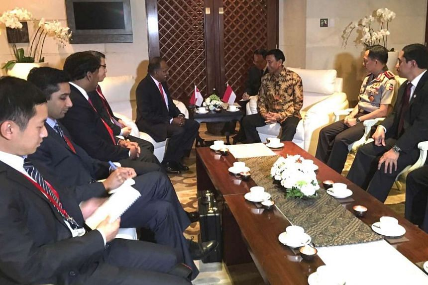 Singapore's Minister for Home Affairs and Law K. Shanmugam (left) and Indonesia Coordinating Minister for Legal, Politics and Security Affairs Wiranto in Bali on Aug 10, 2016.