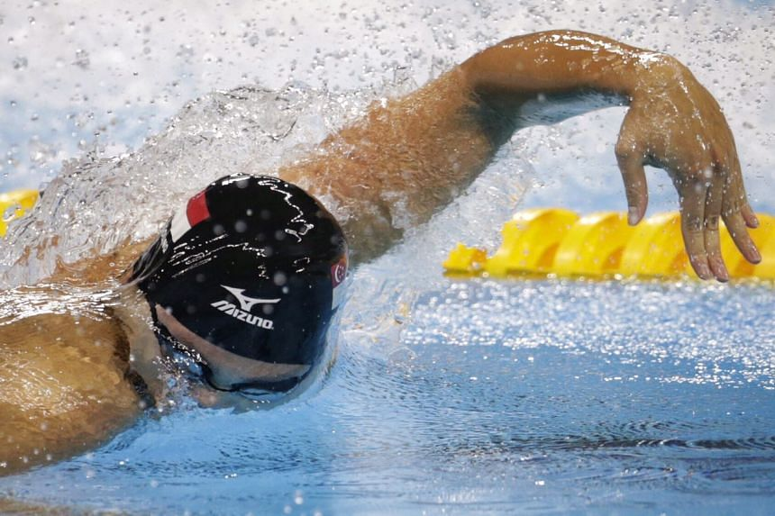 Schooling in action during his semi-final race, where he finished last with a time of 48.7 seconds.