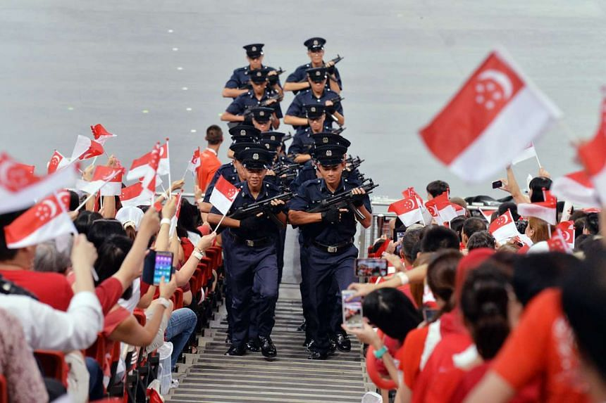 """A contingent from the Police Training Command sends a ripple of excitement through the spectators as they march up the aisles carrying their MP5 sub-machine guns. Instead of the traditional march past, this """"Onward March"""" into the crowd by the co"""