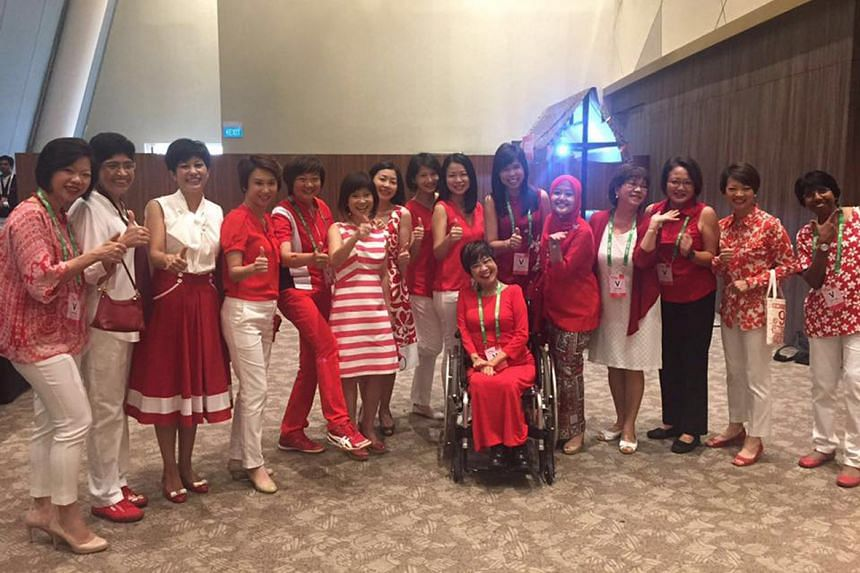 Taking in the excitement at the stadium are women MPs and NMPs (from left) Sim Ann, Fatimah Lateef, Indranee Rajah, Low Yen Ling, Lee Bee Wah, Amy Khor, Cheryl Chan, Sun Xueling, Cheng Li Hui, Chia Yong Yong (in wheelchair), Jessica Tan, Rahayu Mahza