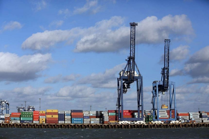 Cranes and shipping containers stand on the dockside at the Port of Felixstowe, a subsidiary of CK Hutchison Holdings, on Feb 2, 2016.