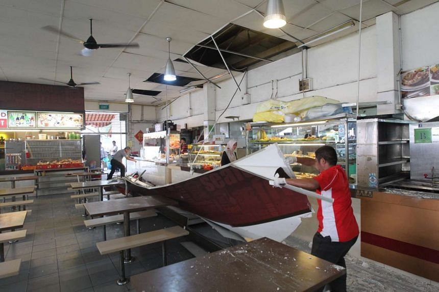Signboards, part of the plaster wall and false ceiling fell at a MacPherson coffee shop on Aug 10, 2016.