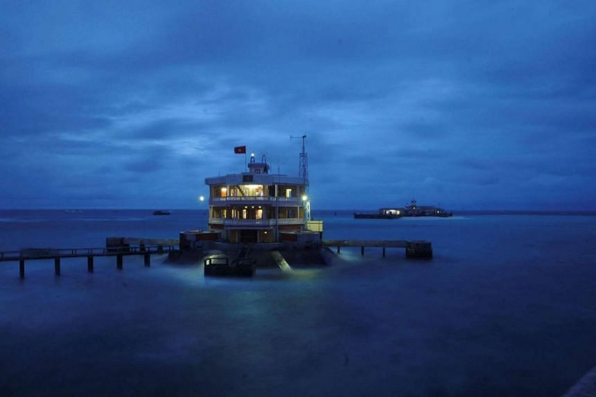 A general view of a building and a pier on Da Tay island in the Spratly archipelago on Jan 6, 2013.