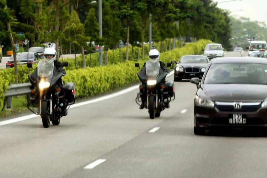 The two-man team from the Traffic Police's Special Operations Team on the new unmarked motorbikes on the roads yesterday along the Pan-Island Expressway.