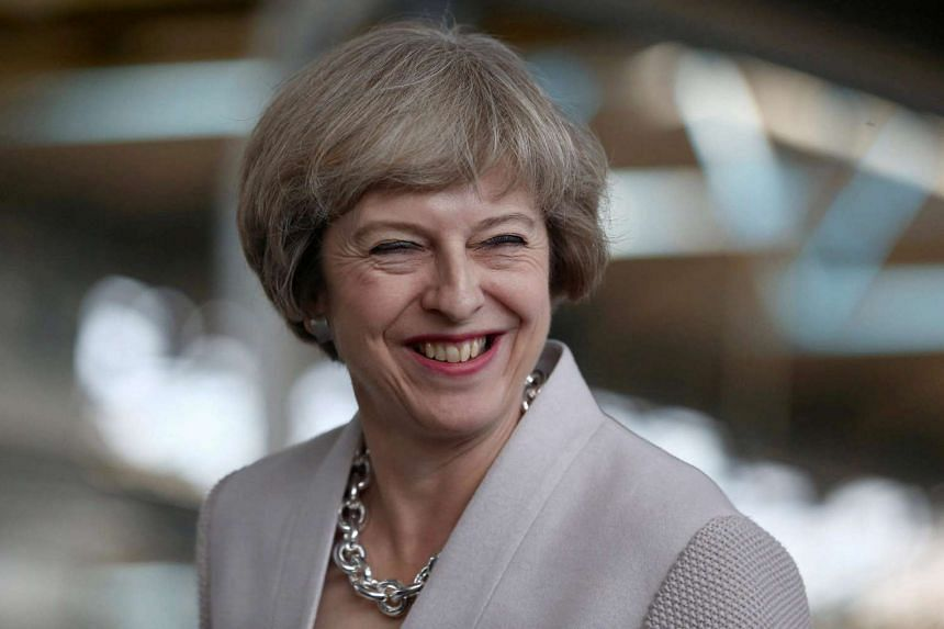Britain's Prime Minister Theresa May visiting a joinery factory in London on August 3.