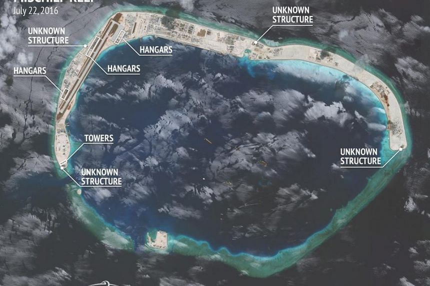 A handout satellite image provided by the Center for Strategic and International Studies/Asia Maritime Transparency Initiative/Digital Globe on Aug 9 shows the Mischief Reef in the South China Sea.