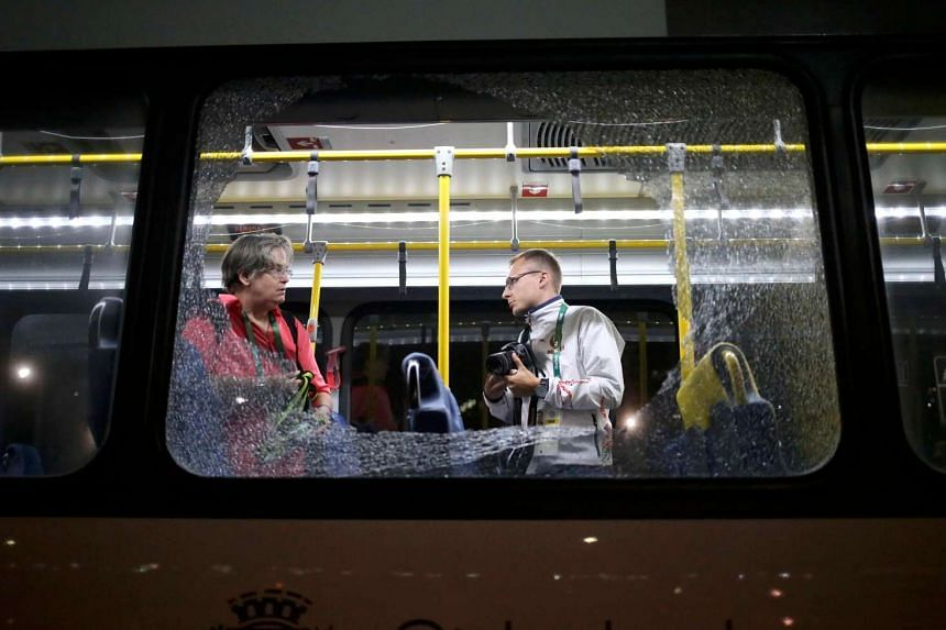 Broken windows on an official media bus after it was hit by stones hurled by vandals on August 9 night.