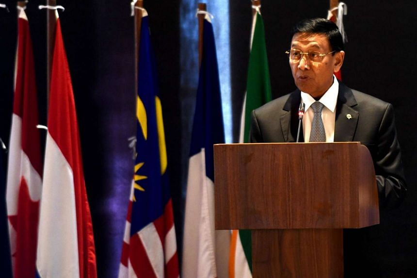 Indonesia Coordinating Minister for Legal, Politics and Security Affairs Wiranto speaks during a conference on counter-terrorism in Nusa Dua on the Indonesian resort island of Bali on August 10.