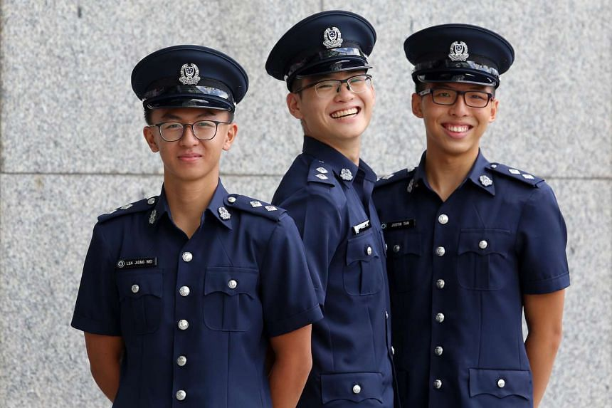 (From left) Mr Lua Jiong Wei, Mr Kagen Lim and Mr Justin Tan, who are all recipients of the SPF Scholarship.
