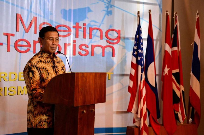 Indonesia Coordinating Minister for Legal, Politics and Security Affairs Wiranto speaks to journalists during a press conference on counter-terrorism in Nusa Dua on the Indonesian resort island of Bali on August 10.