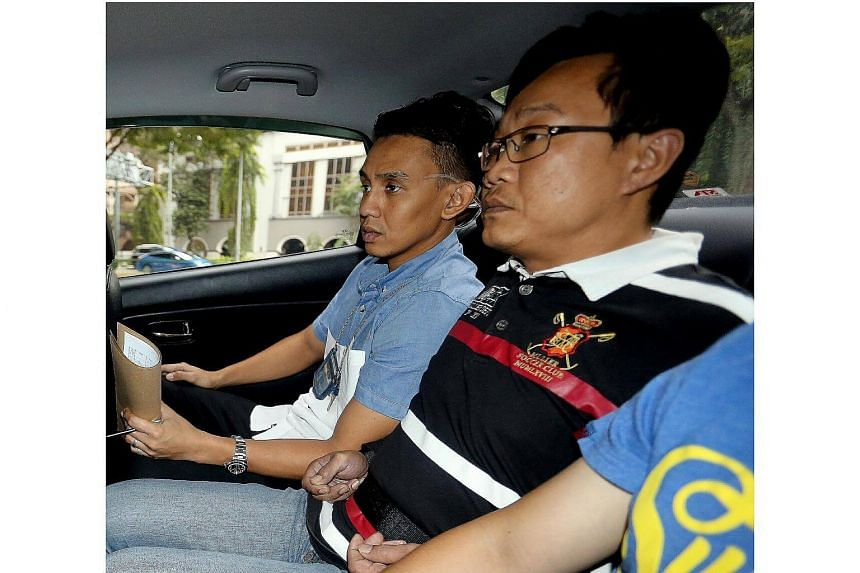 Ho Yueh Keong (middle) was sentenced to 20 months in jail for harbouring one of Singapore's most notorious gangsters, Tan Chor Jin.