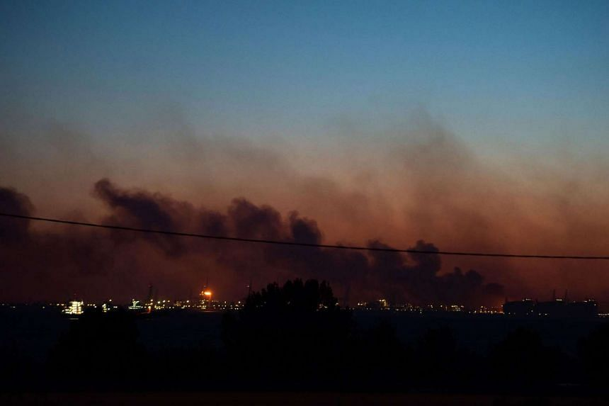 Smoke over the industrial area in Fos-sur-Mer, southern France coming from a fire that spread above the highway near Vitrolles on Aug 10, 2016.