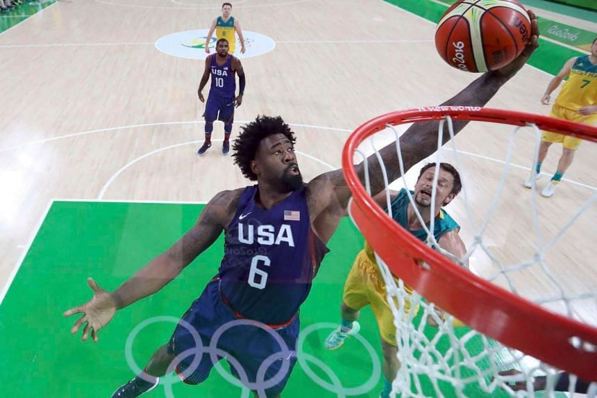 Deandre Jordan of the USA pulls in a rebound over David Andersen of Australia during the men's preliminary basketball match at  Rio de Janeiro, Brazil on August 10.