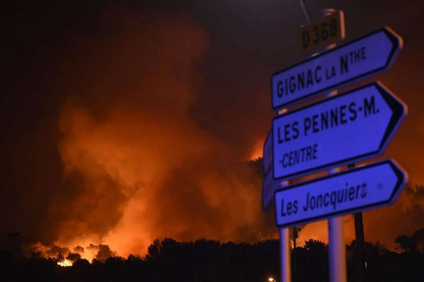 A fire blazes at Les Pennes-Mirabeau, near Marseille, southern France on Aug 11, 2016.