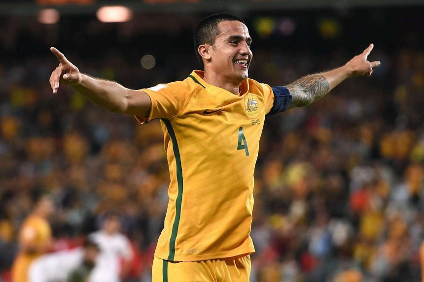 Australian football player Tim Cahill celebrates after scoring his second goal in the Group B 2018 Fifa World Cup qualifying match in Sydney, on March 29, 2016.
