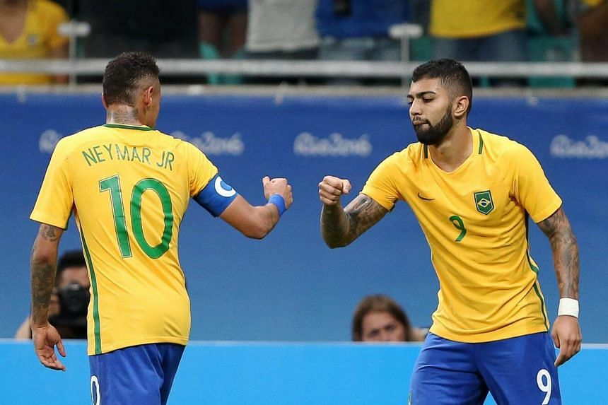 Gabriel Barbosa celebrates his goal with Neymar at the men's soccer preliminary during the 2016 Rio Olympics.