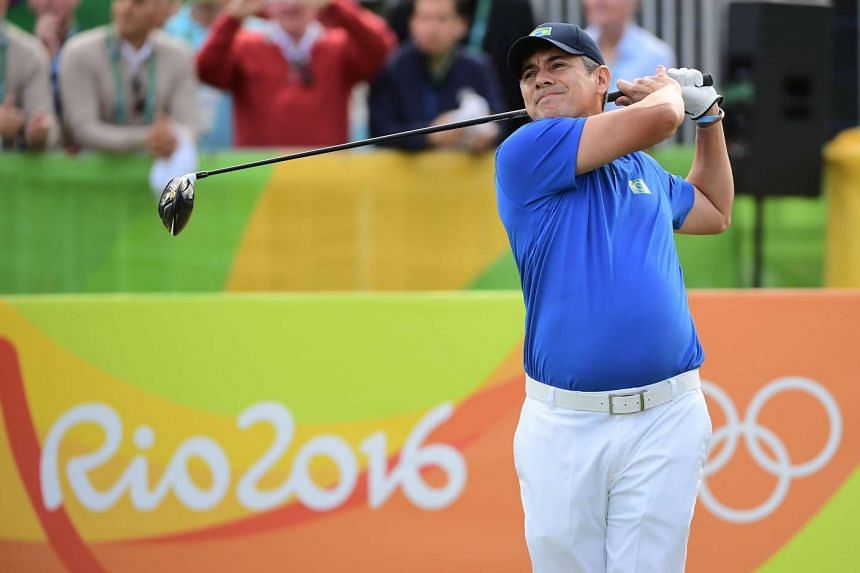Brazil's Adilson Jose Da Silva hits the first Olympic golf stroke in 112 years in the men's individual stroke play at the Rio 2016 Olympic Games on Aug 11, 2016.