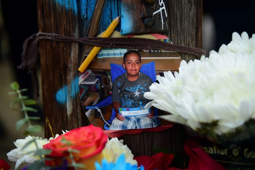 An old photo of Jesse Romero is seen at a vigil in the Boyle Heights section of Los Angeles, on Aug 10, 2016.