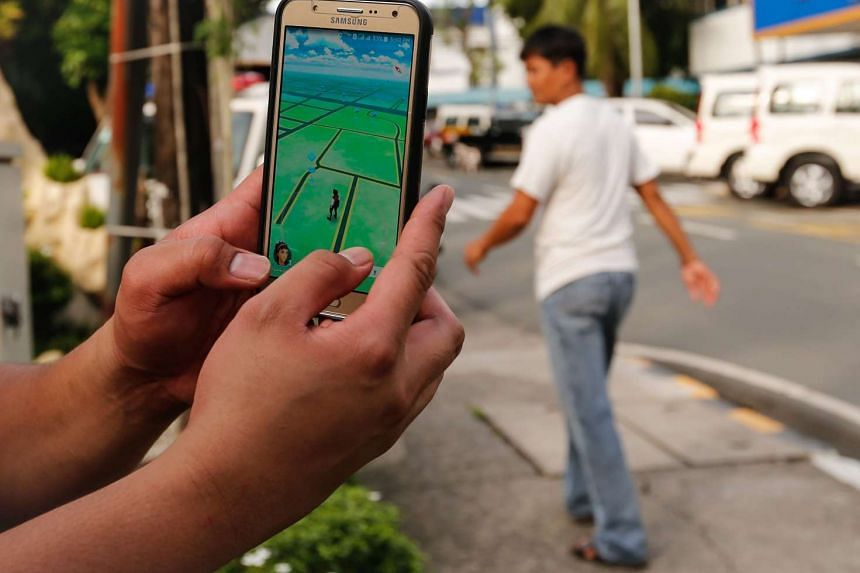 A Filipino plays Pokemon Go on his smartphone in Quezon City, Philippines on Aug 7, 2016.