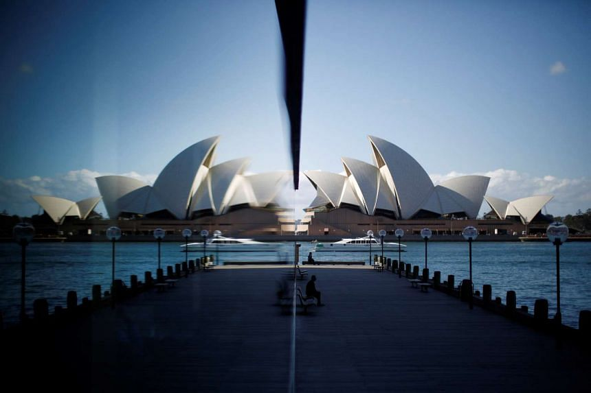 The Sydney Opera House is reflected in a harbourside hotel window in The Rocks district of Sydney, on May 7, 2014.