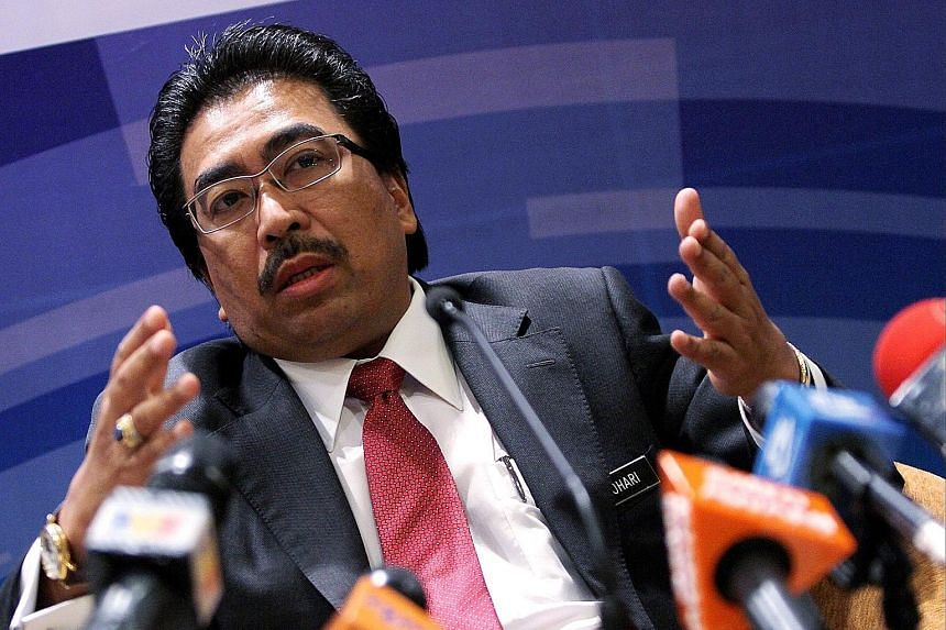 """Malaysia's Second Finance Minister Johari Abdul Ghani says his ministry, which owns 1MDB and provided indemnity on the deal with Abu Dhabi's IPIC, is """"trying to see if we can settle this amicably"""". The case heads into arbitration next month."""
