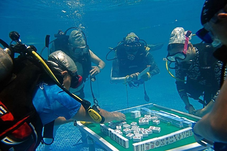 You've heard of the ice bucket challenge. Well, mahjong enthusiasts in the Chinese city of Chongqing have taken the plunge for their passion, diving to the bottom of a swimming pool on Sunday for this contest, open only to certified divers. It must s