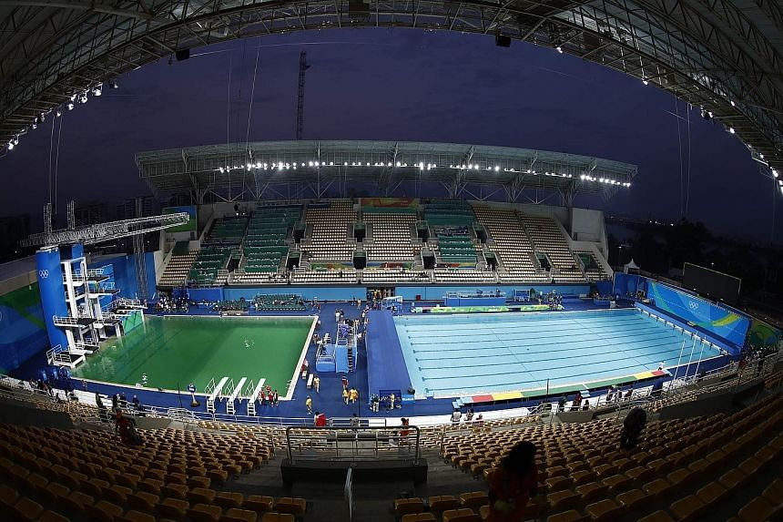 The Maria Lenk Aquatics Centre's diving pool water (left) contrasts sharply with the normal light-blue of the adjacent water-polo pool. Water tests on the diving pool found there was no risk to athletes' health, said Mr Simon Langford, the venue's me