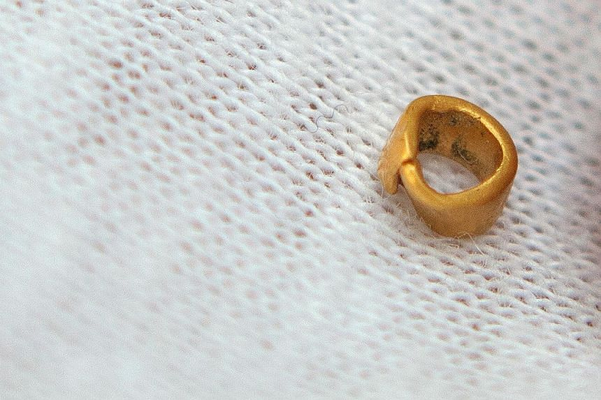 It may be just a tiny gold bead (above) - 4mm in diameter - but it is an enormous discovery for Bulgarian archaeologists who say they have found Europe's - and probably the world's - oldest gold artefact. The bead, found at a pre-historic settlement