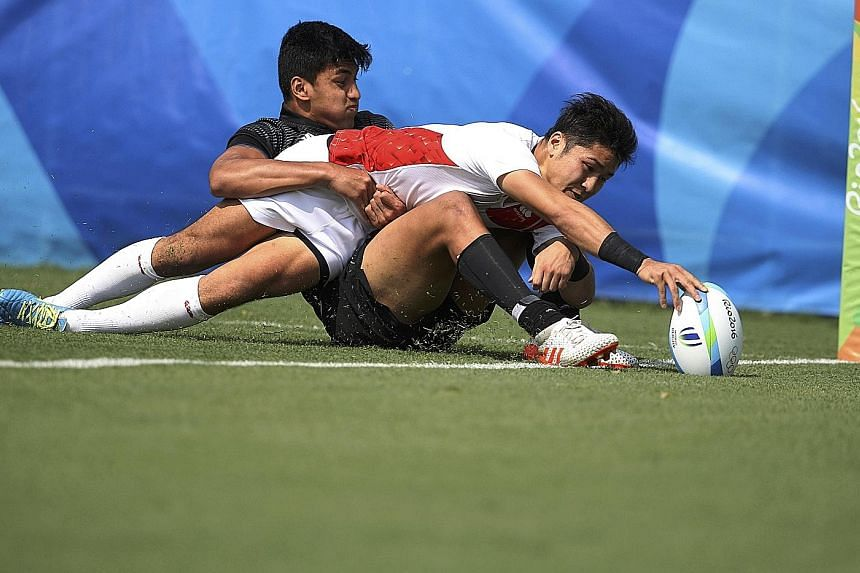 Kazushi Hano of Japan scoring a try during his side's 14-12 win over New Zealand while being tackled by Rieko Ioane. New Zealand coach Gordon Tietjens believes this result shows the gap between both teams has narrowed considerably.