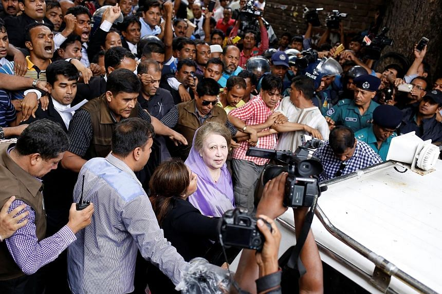 Khaleda Zia leaving the court in Dhaka yesterday after being granted bail in the latest charges against her. Her party says the cases have been fabricated and are aimed at keeping Zia, a bitter rival of Prime Minister Sheikh Hasina, under political p