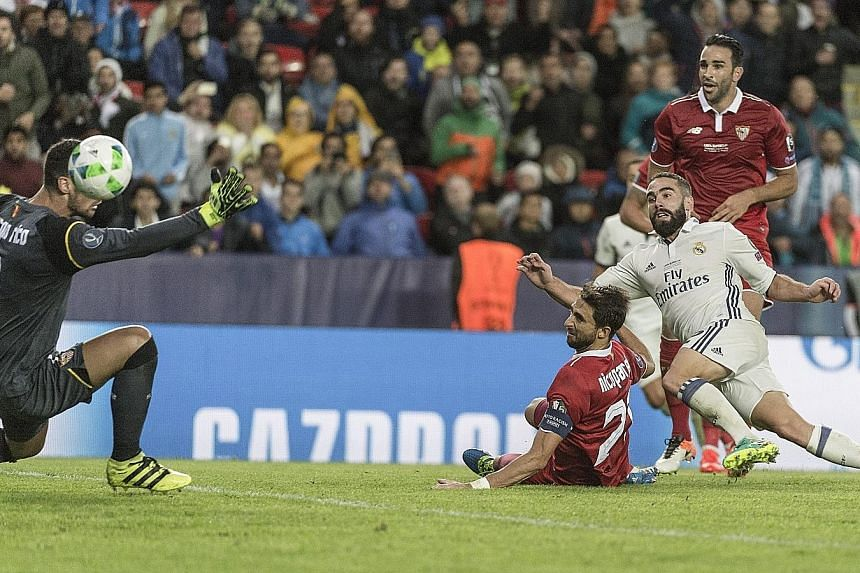 Dani Carvajal (in white) scoring the winning goal in Real Madrid's 3-2 extra-time victory against Sevilla in the Super Cup match in Trondheim, Norway on Tuesday.