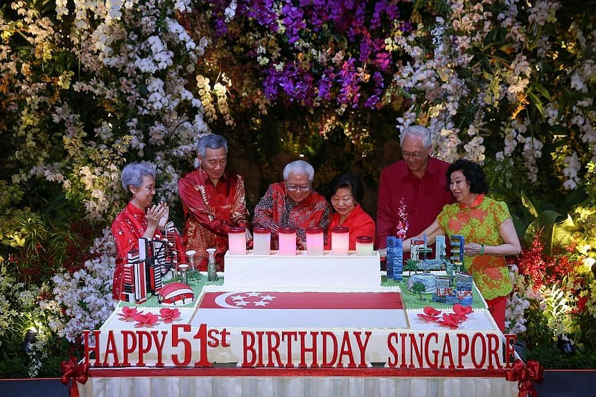 President Tony Tan Keng Yam and his wife Mary are joined by Prime Minister Lee Hsien Loong, Mrs Lee, Emeritus Senior Minister Goh Chok Tong and Mrs Goh at a birthday cake-cutting ceremony at the National Day Reception yesterday evening at the Flower