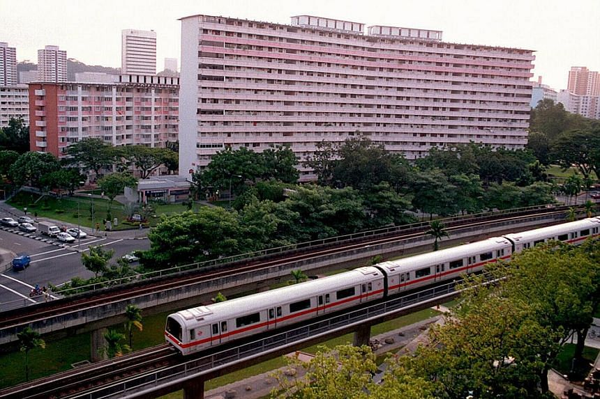 """An MRT train plying the East-West line in Redhill in February 1996. LTA said it is """"reviewing what is the best treatment for older trains - whether to refurbish them or replace them with new trains, to strike a good balance between cost effectiveness"""