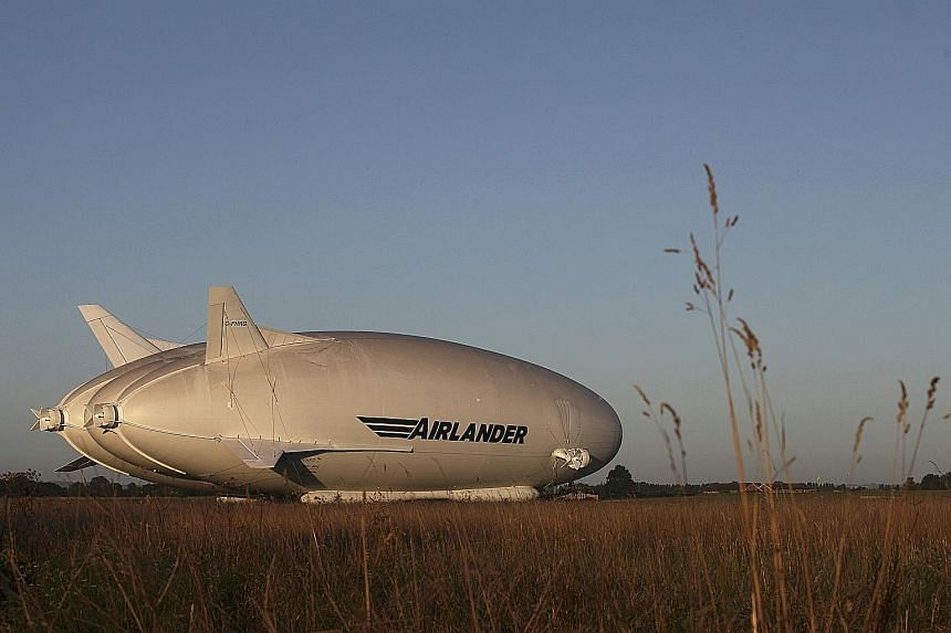 "Originally developed for the US Army as a spy aircraft, the 92m Airlander 10 (top) is seen commencing ground systems tests in central England before its first flight as a civilian aircraft. It is nicknamed ""the Flying Bum"" because of its unique shape"