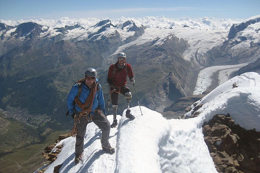 Quadruple amputee Jamie Andrew and a mountain guide in jubilant mood on top of the Matterhorn last Thursday.