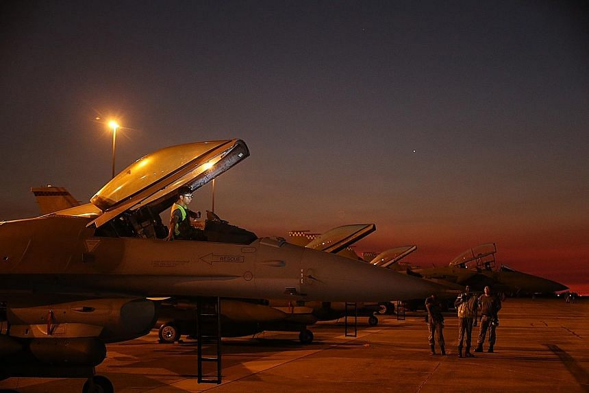 An RSAF engineer checking out an F-16 at the RAAF Base in Darwin yesterday. F-15s and F-16s are among the RSAF planes involved in Exercise Pitch Black, the largest multilateral air combat exercise held in Australia.