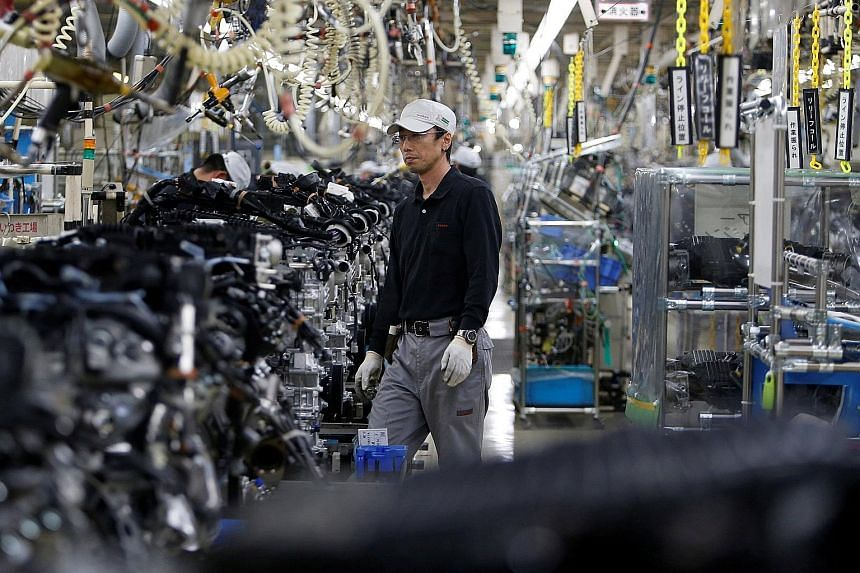 An assembly line of V6 engines at a Nissan plant in Fukushima. Forecasts for gains in machinery orders in July-September suggest that the economy could pick up from what is likely to be a subdued performance in April-June.