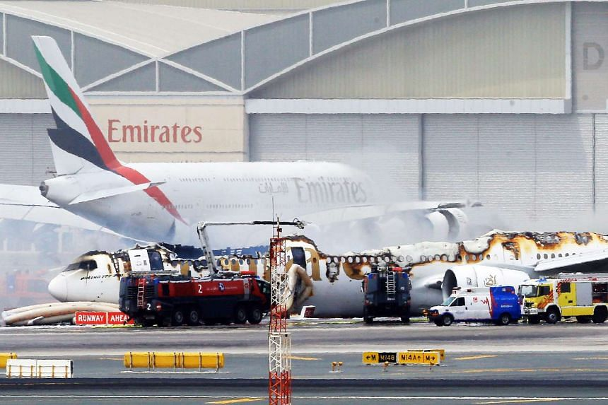 The Emirates Boeing 777-300 sits at Dubai airport after being gutted by fire due to a mechanical failure on Aug 3, 2016.