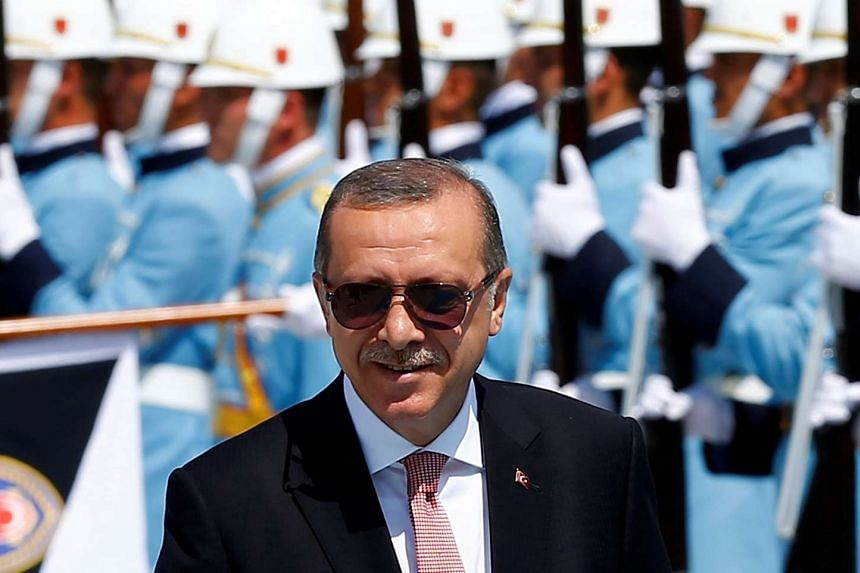 Turkish President Tayyip Erdogan reviews a guard of honour at the Presidential Palace in Ankara, Turkey, Aug 5, 2016.
