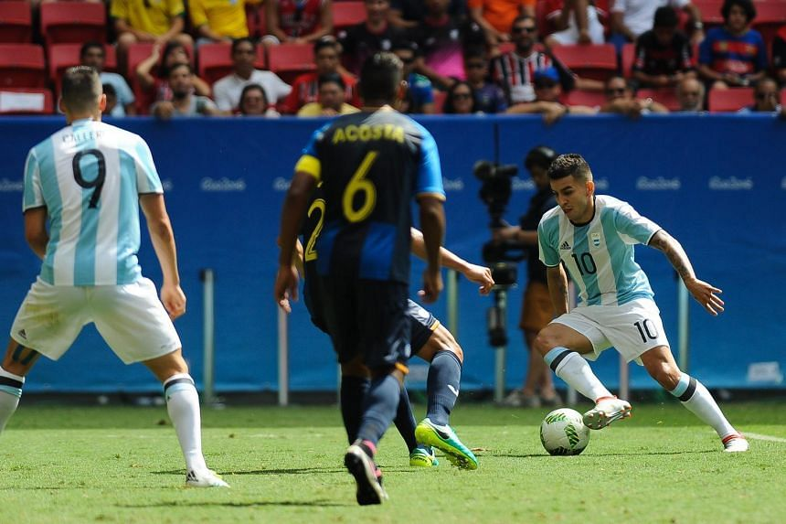 Argentina's football team were knocked out of the Olympics in the group stages after a 1-1 draw with Honduras.